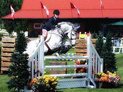 Katrina jumps on Horseback at Show