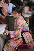 Hmong Girl sitting at the market by Annie Muto