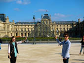 Teddy and Katie Holding the Louvre Pyramid by Sara Obletz
